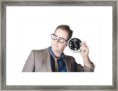 Businessman Holding Clock Near Ear Framed Print by Jorgo Photography - Wall Art Gallery