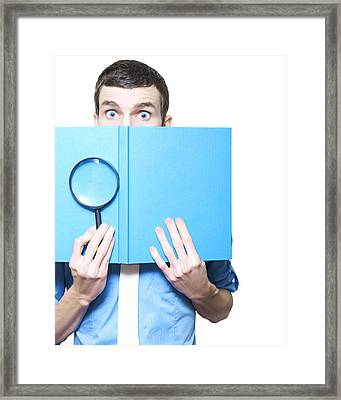 Businessman Holding Magnifying Glass And Book Framed Print by Jorgo Photography - Wall Art Gallery