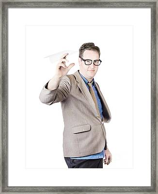 Businessman Holding Paper Airplane Framed Print by Jorgo Photography - Wall Art Gallery