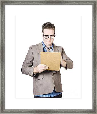 Businessman Looking At Clipboard Framed Print by Jorgo Photography - Wall Art Gallery