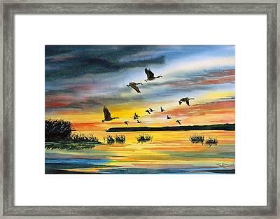 Canadas At Sunset Framed Print