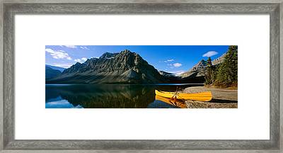 Canoe At The Lakeside, Bow Lake, Banff Framed Print by Panoramic Images