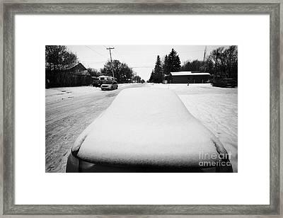car covered in snow parked by the side of the street pleasant hill Saskatoon Saskatchewan Canada Framed Print by Joe Fox
