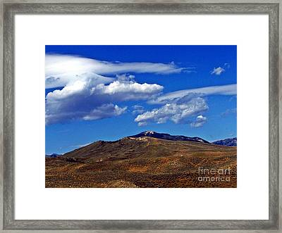 Caressed By Clouds Framed Print by Christian Mattison