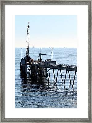 Carpinteria Pier Framed Print by Henrik Lehnerer