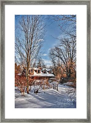 Carriage House In Snow Framed Print