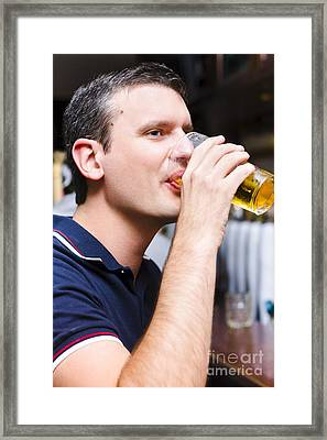 Caucasian Man Drinking Pint Of Beer Inside Pub Framed Print by Jorgo Photography - Wall Art Gallery