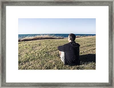 Caucasian Traveler Relaxing On Grass Outdoors Framed Print by Jorgo Photography - Wall Art Gallery