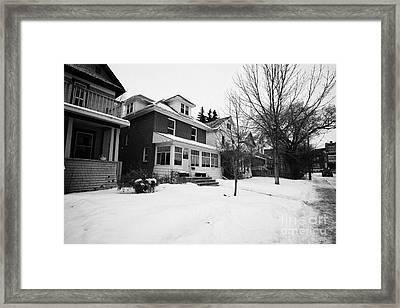 character homes during winter in caswell hill Saskatoon Saskatchewan Canada Framed Print by Joe Fox