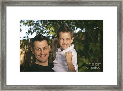 Cheering Child And Man Bonding On Fathers Day Framed Print