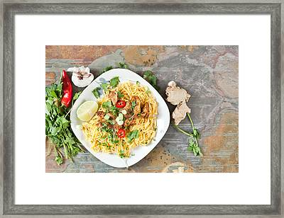 Chicken Noodles Framed Print by Tom Gowanlock