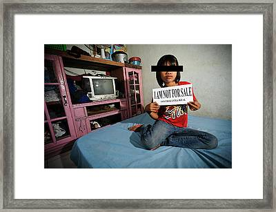Child With Sign Framed Print