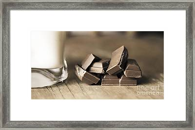 Chocolate Pieces Sitting On Wooden Kitchen Bench Framed Print