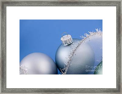 Christmas Baubles On Blue Framed Print by Elena Elisseeva