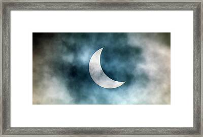 Cloudy Solar Eclipse Framed Print by Martin Dohrn