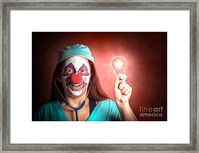Clown Doctor Holding Red Emergency Lightbulb Framed Print by Jorgo Photography - Wall Art Gallery
