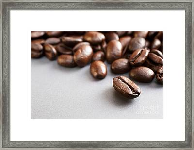 Coffee Beans On Grey Ceramic Surface Framed Print by Colin and Linda McKie