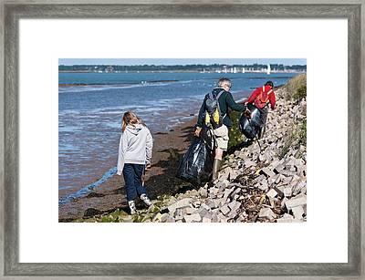 Collecting Litter Framed Print