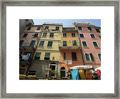 Colorful Buildings With Clothes Hanging Framed Print