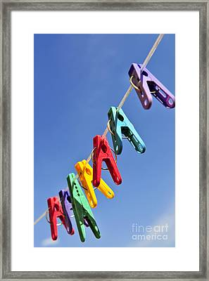 Colorful Clothes Pins Framed Print by Elena Elisseeva