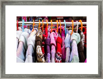 Colorful Coats Framed Print by Tom Gowanlock