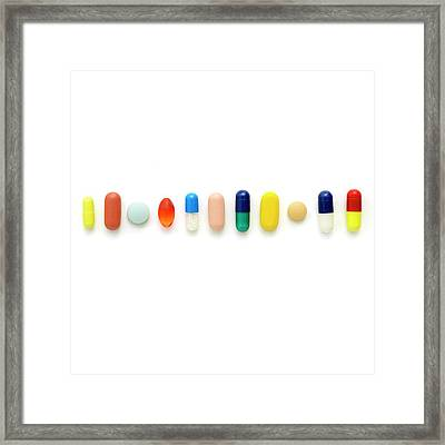 Coloured Capsules And Tablets Framed Print by Science Photo Library