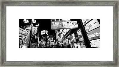 Commercial Signboards Lit Up At Night Framed Print by Panoramic Images