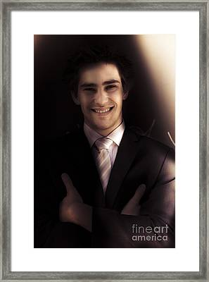 Confident Business Man Smiling In Darkness Framed Print