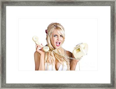 Confused Woman With Retro Phone Framed Print by Jorgo Photography - Wall Art Gallery