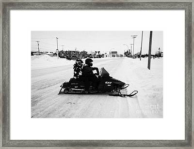 couple on a snowmobile Kamsack Saskatchewan Canada Framed Print