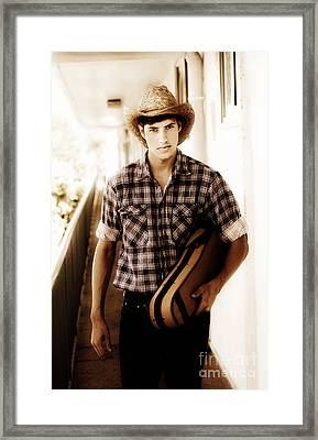 Cowboy Carrying Guitar Framed Print