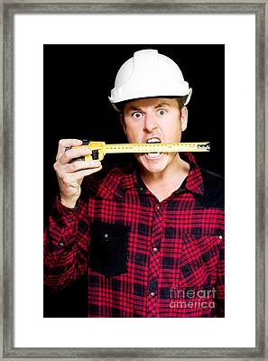 Crazy Builder Biting His Tape Measure Framed Print by Jorgo Photography - Wall Art Gallery