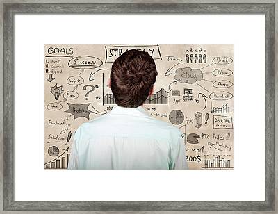 Creative Businessman Looking To Plan Business Idea Framed Print by Jorgo Photography - Wall Art Gallery