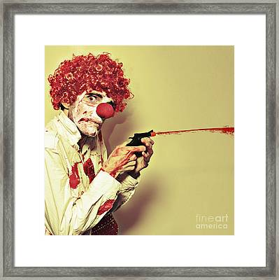 Creepy Manic Clown Shooting Blood From Cap Gun Framed Print by Jorgo Photography - Wall Art Gallery