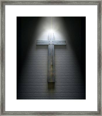 Crucifix On A Wall Under Spotlight Framed Print by Allan Swart