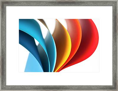 Curves Of Colored Papers On White Framed Print by Colormos