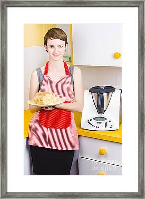 Cute Baking Woman Holding Fresh Bread In Kitchen Framed Print
