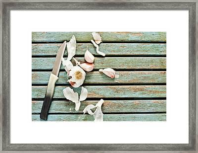 Cutting Garlic Framed Print by Tom Gowanlock