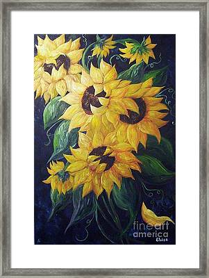 Dancing Sunflowers  Framed Print by Eloise Schneider