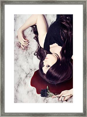 Dead Woman Holding Black Flower In Blood Puddle Framed Print