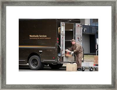 Deliver Driver Loading His Van Framed Print by Jim West
