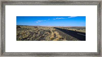 Desert Road Passing Framed Print by Panoramic Images