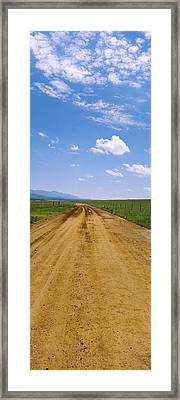 Dirt Road Passing Through A Landscape Framed Print by Panoramic Images