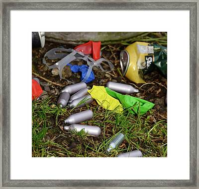 Discarded Laughing Gas Capsules Framed Print by Cordelia Molloy