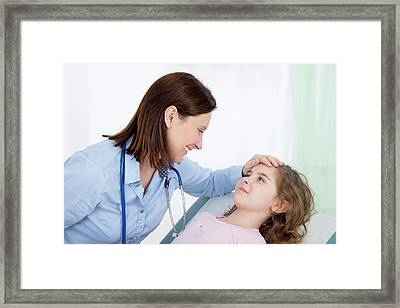 Doctor Caring For Girl Framed Print by Lea Paterson