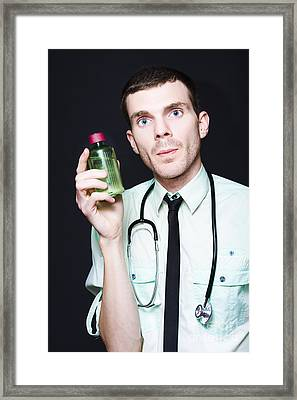 Doctor Holding Cold And Flu Cough Medicine Framed Print by Jorgo Photography - Wall Art Gallery