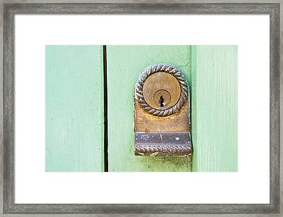 Door Lock Framed Print by Tom Gowanlock