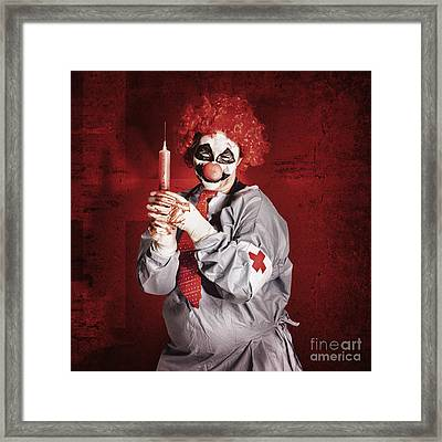 Dr Death Clown With Big Red Hypodermic Needle Framed Print by Jorgo Photography - Wall Art Gallery