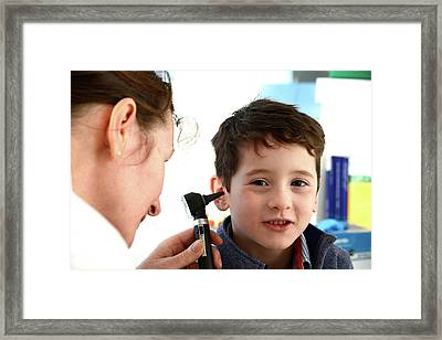 Ear Examination Framed Print