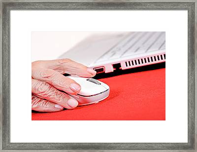 Elderly Woman Using A Computer Mouse Framed Print by Aj Photo
